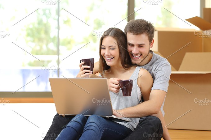 Couple buying online and moving house.jpg - Technology