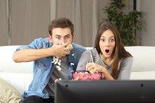 Amazed couple watching tv.jpg