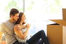 Couple hugging moving new house.jpg