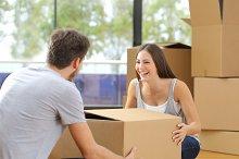 Couple lifting box moving home.jpg