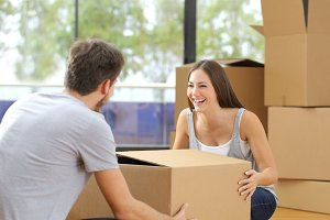 Couple lifting box moving home.jpg