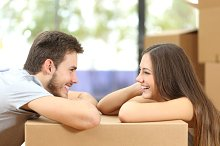 Couple moving house looking each other.jpg
