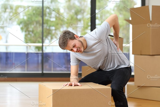 Man suffering back ache moving boxes.jpg - Health