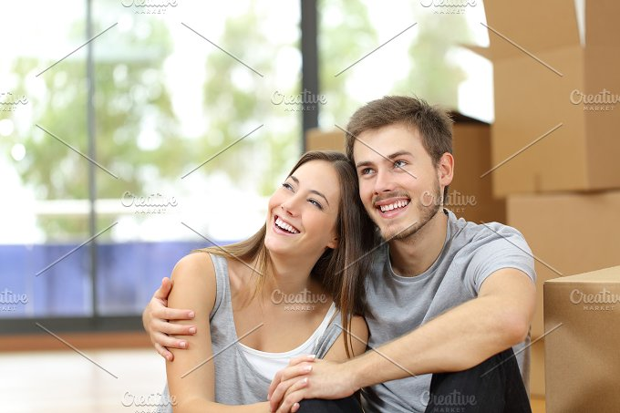 Happy couple moving home planning.jpg - People