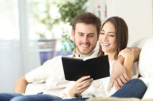 Couple reading a guide in an ebook.jpg