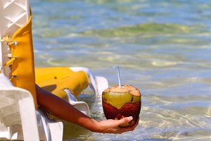 girl's hand holding a coconut