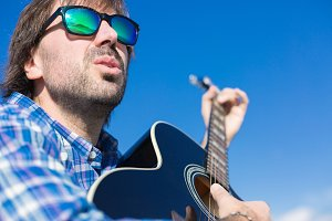 Bearded man in sunglasses singing