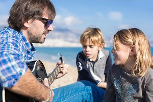 Children and father singing song