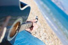 Close-up of man hands playing guitar