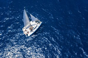 Sailing Catamaran in open sea