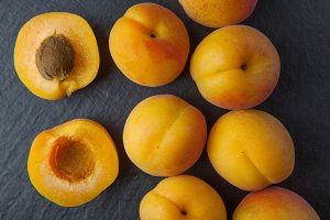 Apricots on dark background