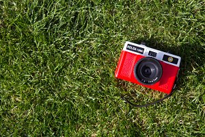 Retro red camera in grass