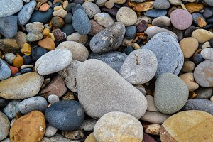 Rounded beach pebbles background