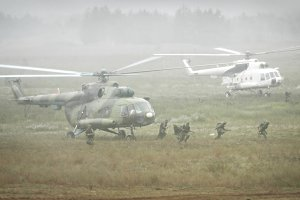 Helicopters and soldiers
