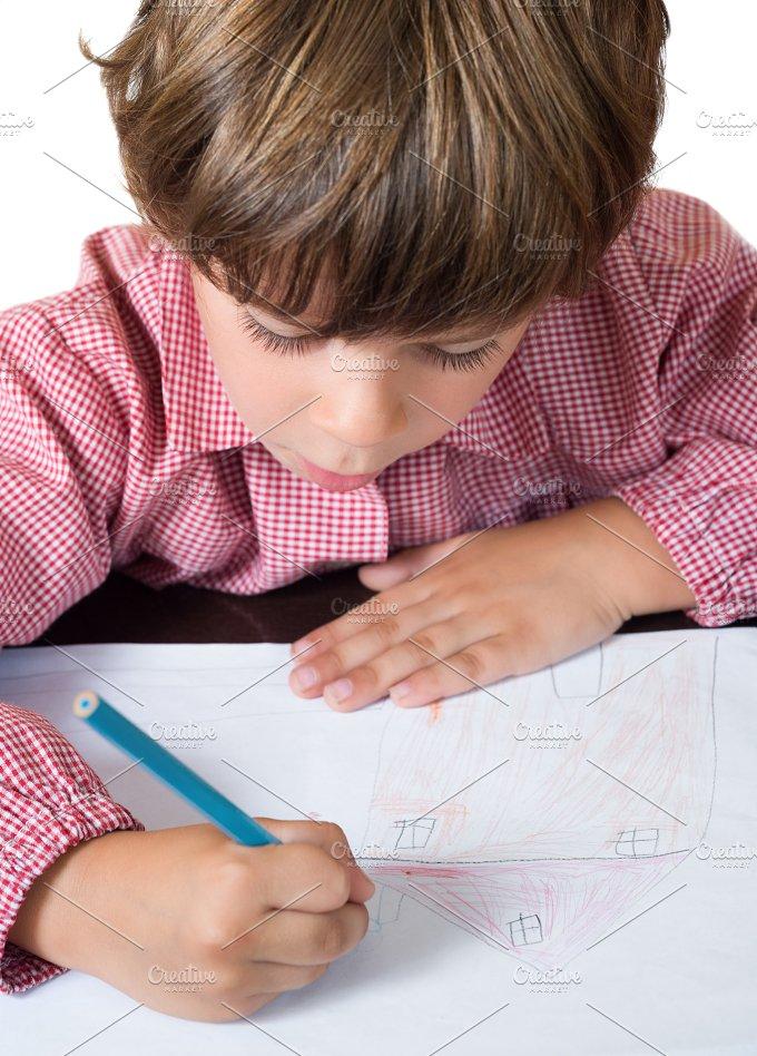 child draws a house at school.jpg - Education