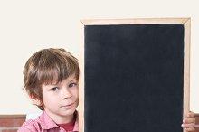 school blackboard child points.jpg