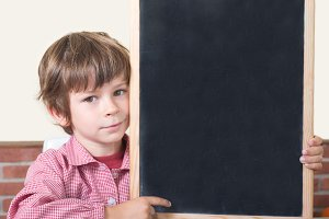 school blackboard child points.jpg