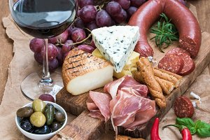 Glass of red wine, cheese & meat