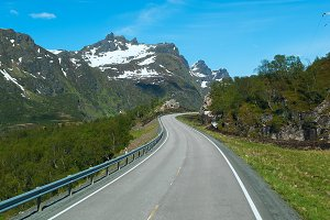 Grey road on Norvegian mountains in sunny clear day.jpg