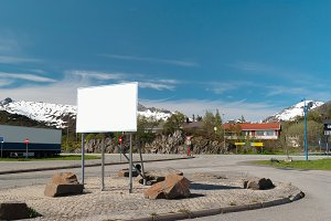 Big white bilboard on norwegian road in sunny summer day.jpg