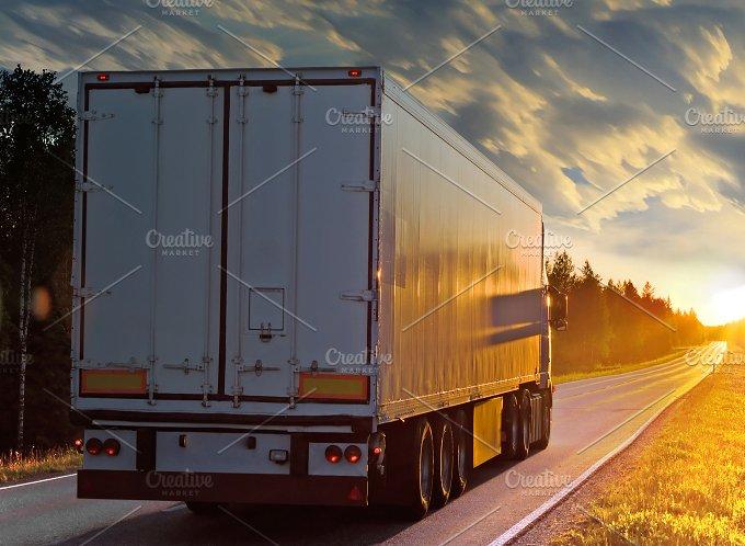 White truck on the rural road in evening.jpg - Transportation