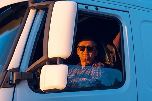 Driver in the cabin of him white truck.jpg
