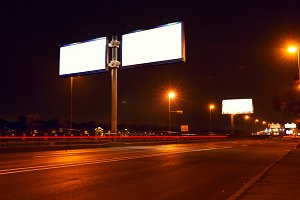 Big white billboard on lighting street at night.jpg