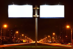 Double big white bill-board on lighting street at night.jpg
