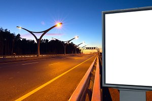 White billboard on lighting highway at night.jpg