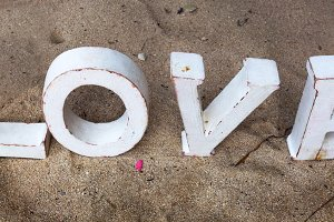 The word love on sand.jpg