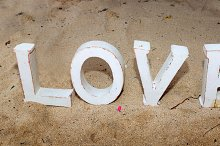 Wooden love letters on sand.jpg