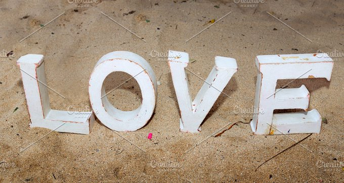 Wooden love letters on sand.jpg - Photos