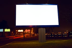 Big white billboard on night street.jpg
