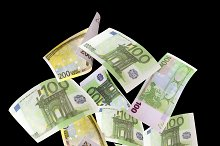Falling euros on black background.jpg