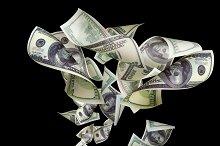 Falling dollars isolated on black background.jpg