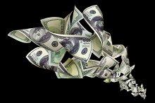Falling dollars on black background.jpg