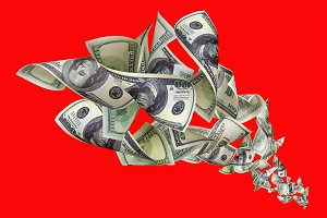 Falling dollars on red background.jpg