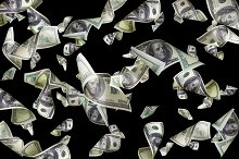 Flying dollars isolated on black background.jpg