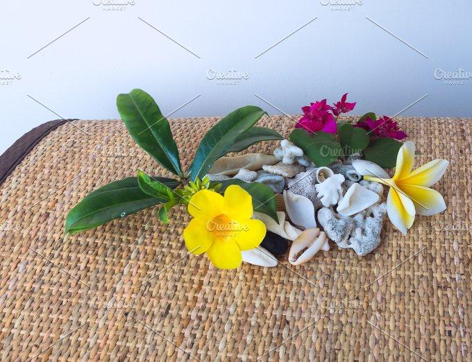 Frangipani flower and yellow flower with white seashells.jpg - Photos
