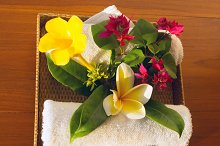 Towels and red, yelow and white flowers.jpg