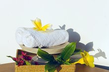 Towels and flowers frangipani on the table.jpg