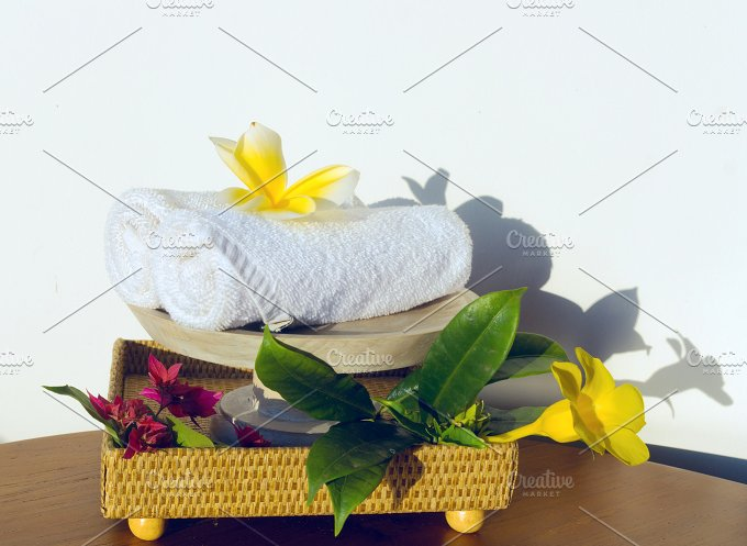 Towels and flowers frangipani on the table.jpg - Photos