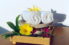 Towels and yellow flowers frangipani.jpg