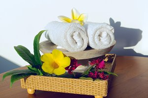 Towels and yellow flowers frangipani.jpg