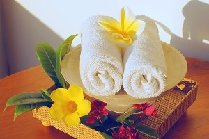 White towels and flowers frangipani.jpg