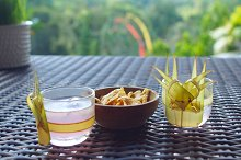 Two glasses of beverage and snack on the table.jpg