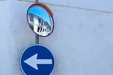 Mirror and the road sign on the wall.jpg