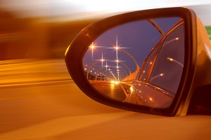 Reflection of high-speed road on car's mirror.jpg