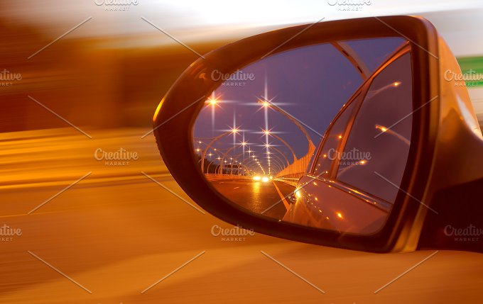 Reflection of high-speed road on car's mirror.jpg - Transportation