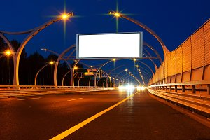 Big white billboard on night highway.jpg